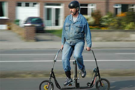 This guy is a huge loser, but for a slightly different reason. Maybe it's his denim jacket & jeans combo. Maybe it's his extra long fu manchu. But it's probably just his dual-dildo sideways bike.